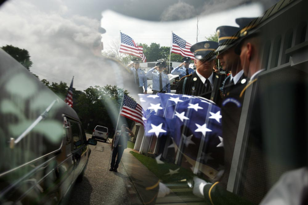 The casket of Cpl. Joshua Alexander Molina, 20, who passed away on March 27, 2008 while honorably serving his country in Iraq is transfered from St. Matthews Episcopal Church to Houston National Cemetery.