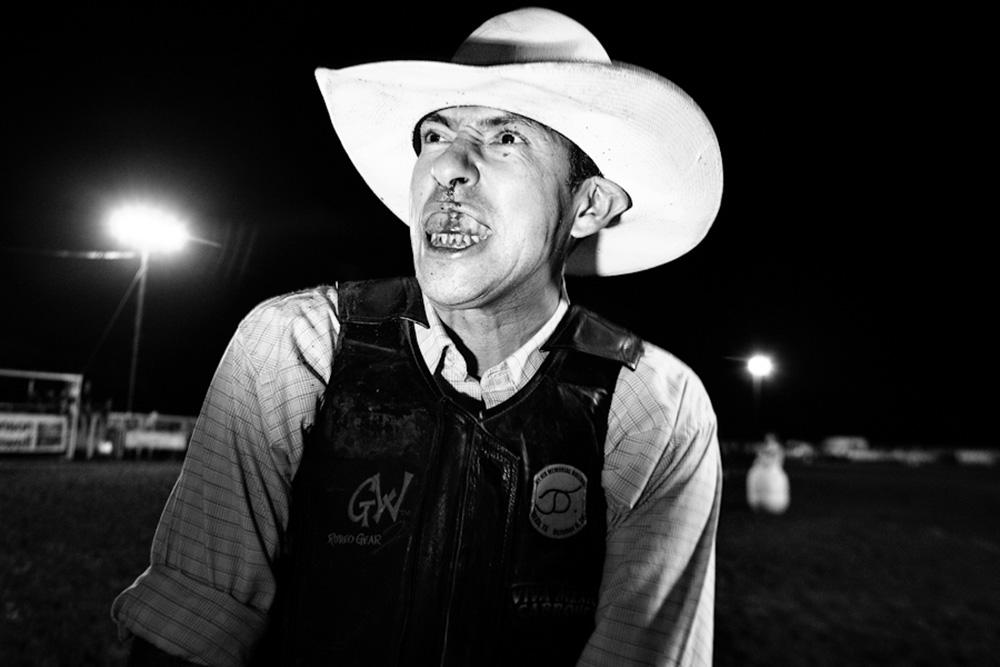 "Jimmy ""Stretch"" Borunda of San Antonio, Texas is injured during a bull ride in Johnson City, Texas.  August 16, 2008. © Lance Rosenfield"
