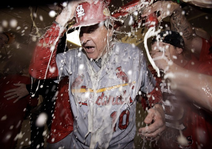 St. Louis Cardinals manager Tony La Russa and players celebrate after Game 6 of baseball's National League championship series against the Milwaukee Brewers Sunday, Oct. 16, 2011, in Milwaukee. The Cardinals won 12-6 to win the series and advance to the World Series.