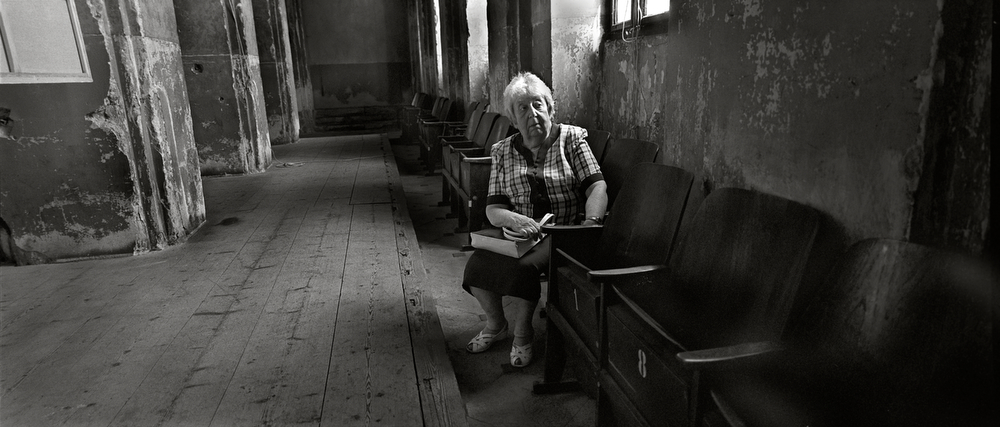 Helga Weiss, photographed at the Liben Synagogue -  Prague, Czech Republic, June 2012. Helga and her parents were transported to Terezin in January 1942. Hidden in her parents luggage, among their allowable personal belongings, was their daughters paints, brushes and notebooks. Starting with these basics, then supplementing them with purloined art supplies from the inmate staffed Nazi propaganda art studio, Helga was able to produce more than 100 scenes of  life and death during her nearly 3 years of imprisonment at Terezin.