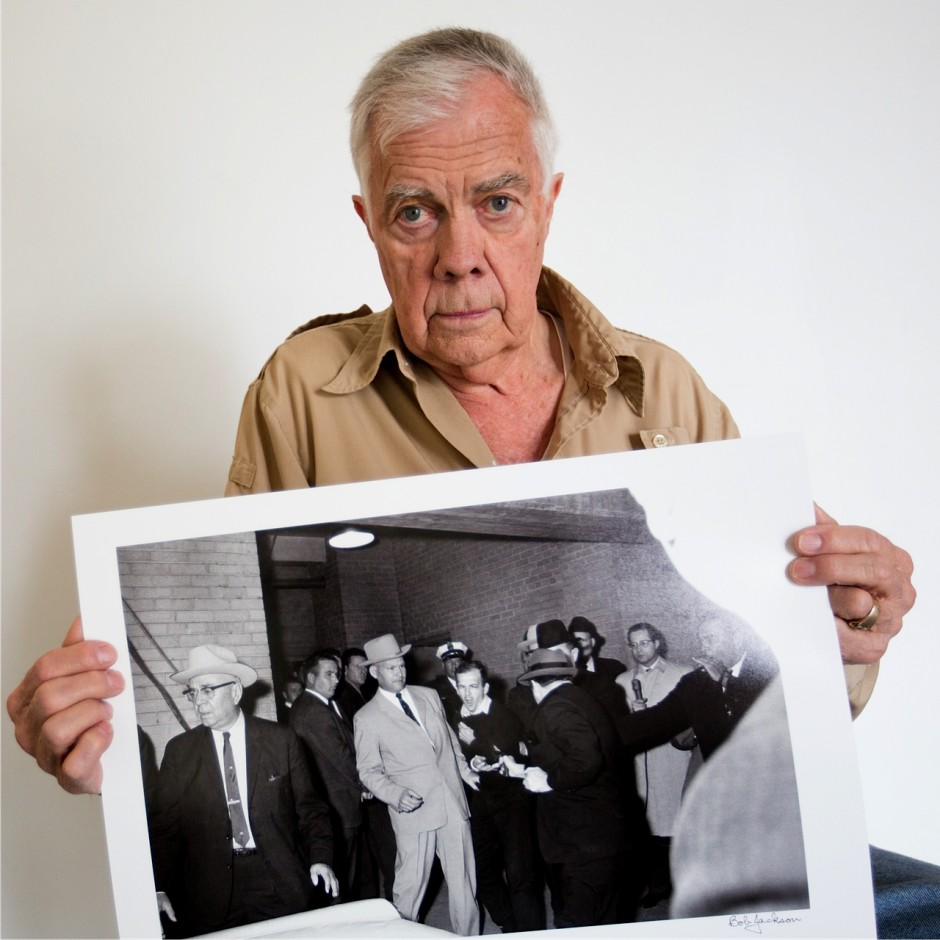 Portrait of Bob Jackson with his photograph of Lee Harvey Oswald being shot by Jack Ruby Allison V. Smith ©